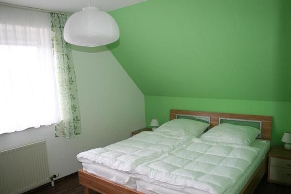 Ferienwohnung bornemann 11519 ferienwohnung wulfen for Echtholztisch wohnzimmer