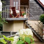 Aufgang zur Ferienwohnung mit Terrasse im OG