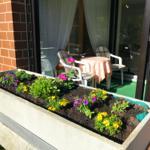 Der Wintergarten wird im Sommer zur Loggia (überdachter Balkon)