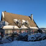 Haus Schneekappe im Winter