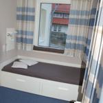 2. Schlafzimmer mit 2 Einzelbetten. Ein Bett davon auch als Doppelbett nutzbar.