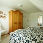 Gästehaus Agricola - Ferienwohnung 2 - Schlafzimmer