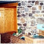 Saunalandschaft mit  Blockhaus-Bio (65Grad)- und Finnsauna (85 Grad), Solarium sowie Ruhe- und Fitnessraum