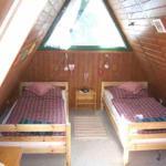 Das Ferienhaus verfügt über insgesamt drei separate Schlafräume. Hier sehen Sie das gemütliche Schlafzimmer im 1. Stock.