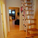 Raumspartreppe in die zweite Etage. Ein separater Aufgang ist zusätzlich vorhanden.