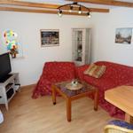 Wohnzimmer mit Flat-TV, Radio/CD