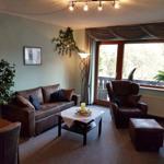 Wohnzimmer Couch und Balkon ausgang